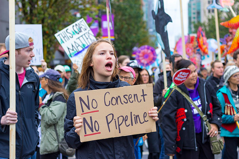 PipelineProtestWomanSign.jpg