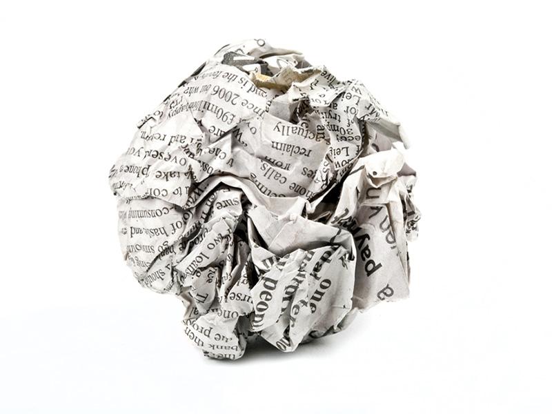 Crumpled newspaper ball