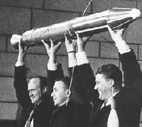 Scientists lifting rocket like it's the heavyweight title belt