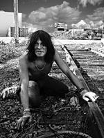 Homeless man near train tracks, on all fours