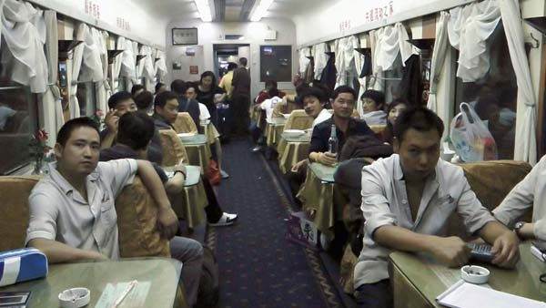 Chinese people on a crowded train car