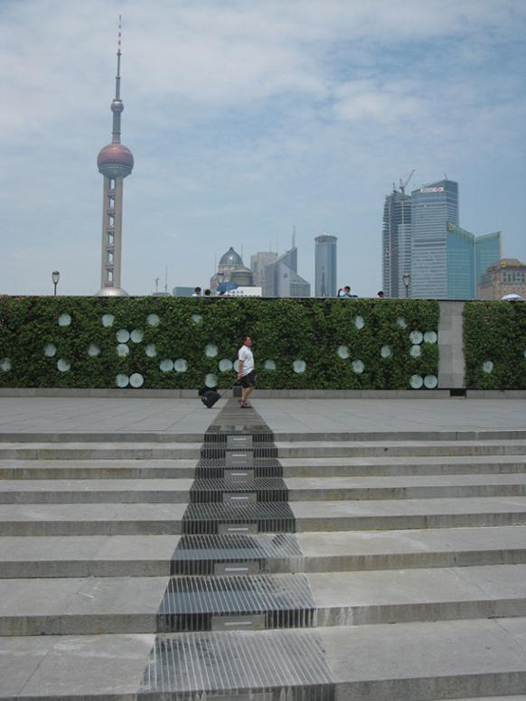 582px version of A man walking on The Bund in Shanghai