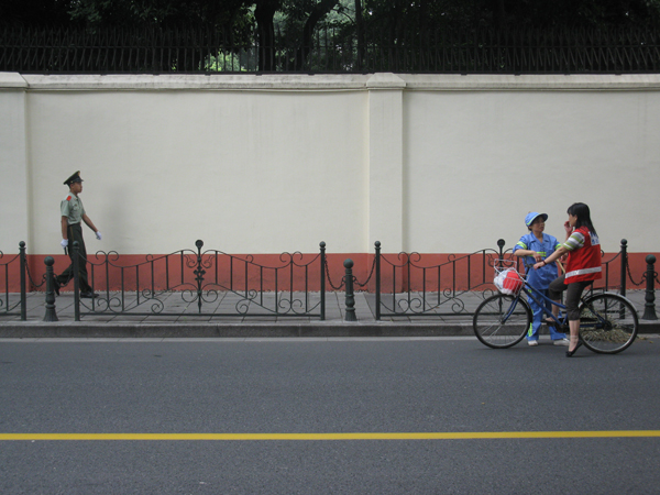 A soldier, cleaner and cyclist in Shanghai