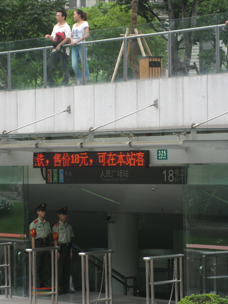 Couples at a Metro station in Shanghai