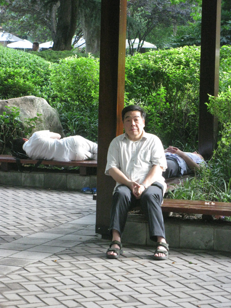 A man wakes from a nap in Shanghai