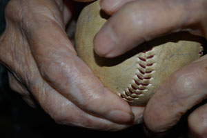Baseball player Conrado Marrero's hands with ball