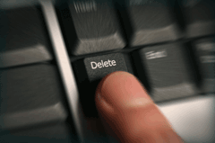 Finger on Delete button