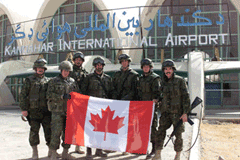 Soldiers with flag in Kandahar