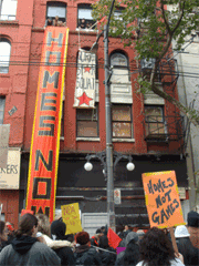 Building with protestors and vertical banner