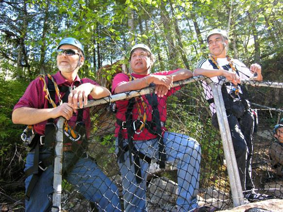 582px version of Three men at a tribal park zipline