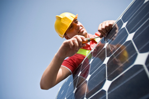 Solar panel construction worker