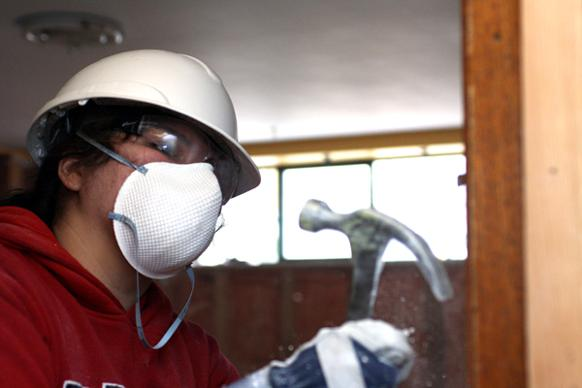 582px version of Worker deconstructing drywall