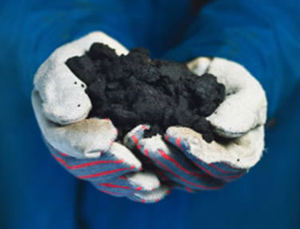 Tar in gloved hands