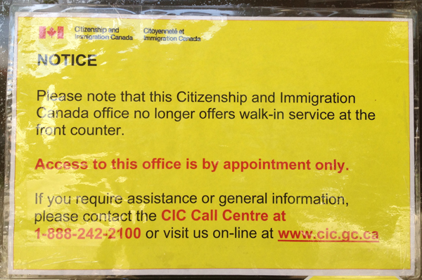Laminated sign taped to the doors of the remaining Citizenship and Immigration Canada