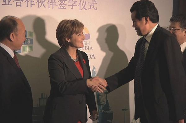 Christy Clark shaking hands