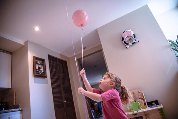 582px version of Girl playing with balloon