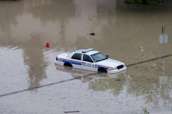 582px version of Police car trapped in the Calgary deluge