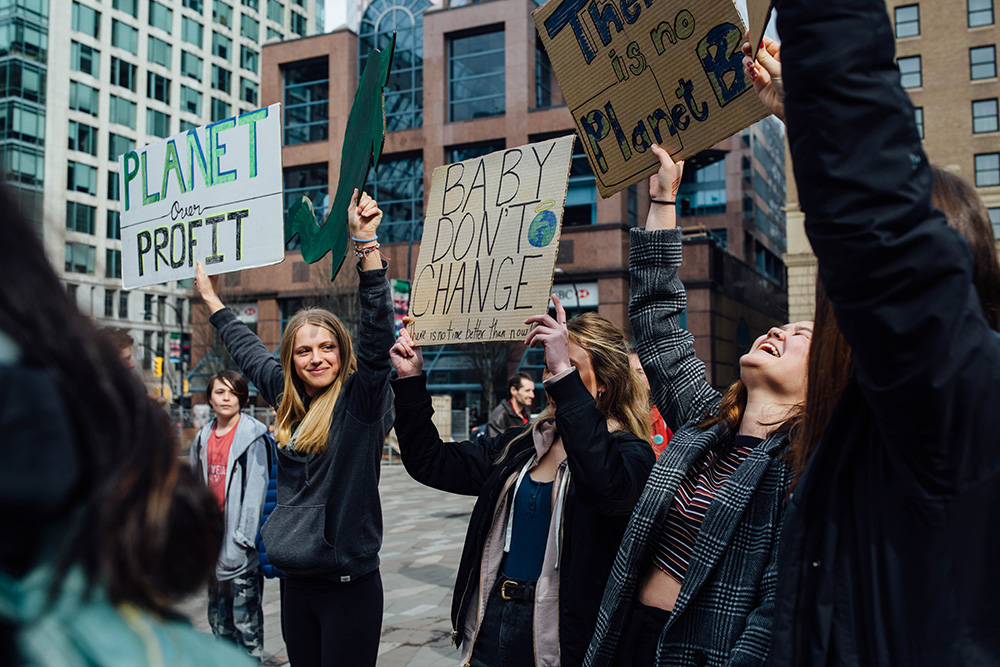 851px version of YouthClimateStrike_CrowdSigns.jpg