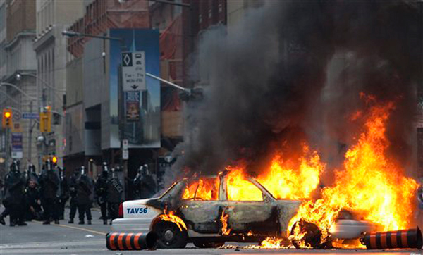 Cop car burning at G20 protest