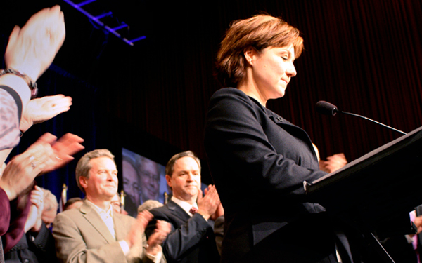 Christy Clark at podium, after victory