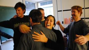Students hugging Professor Bill Rees