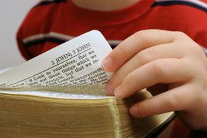 Kid reading bible