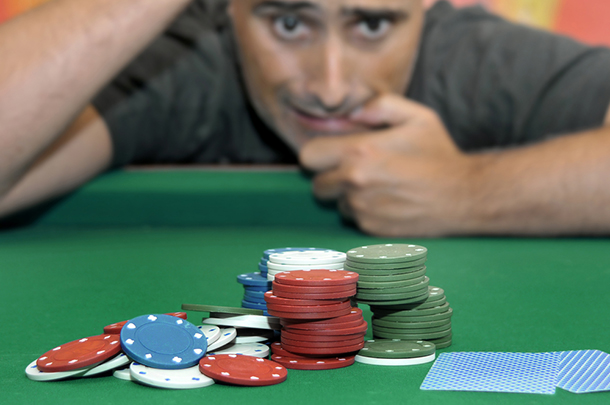 Gambler_At_Table_With_Chips