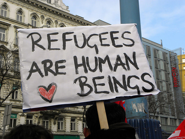 """Refugees are human beings"" sign"