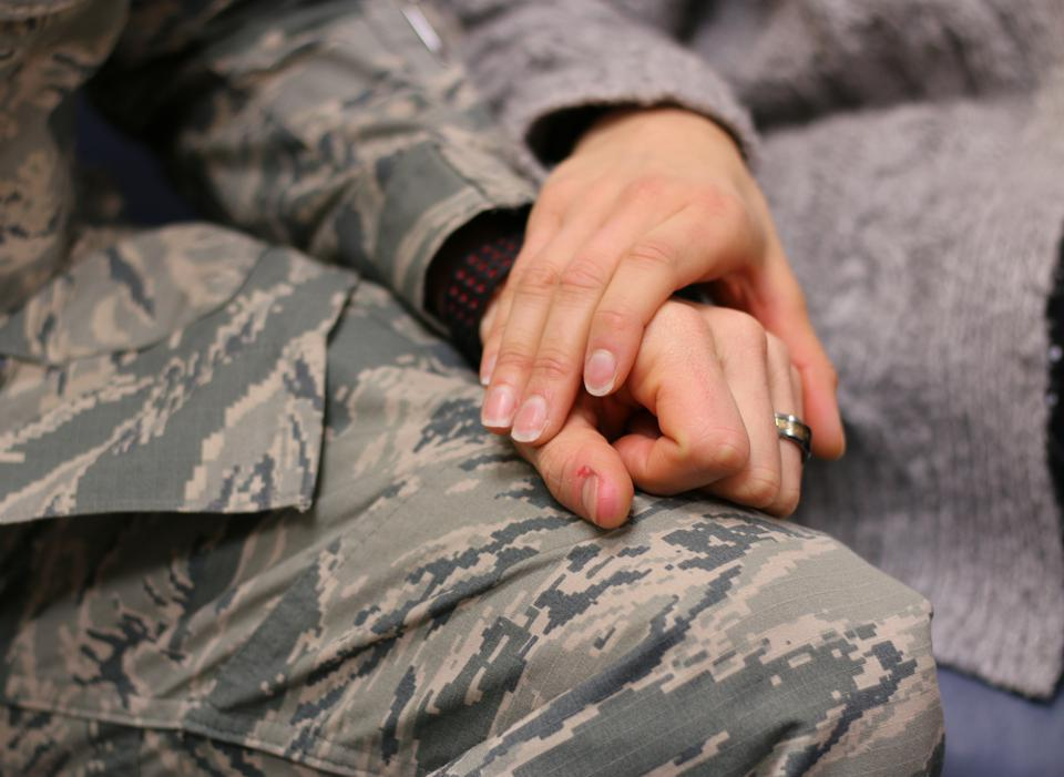 960px version of Soldier holding hands