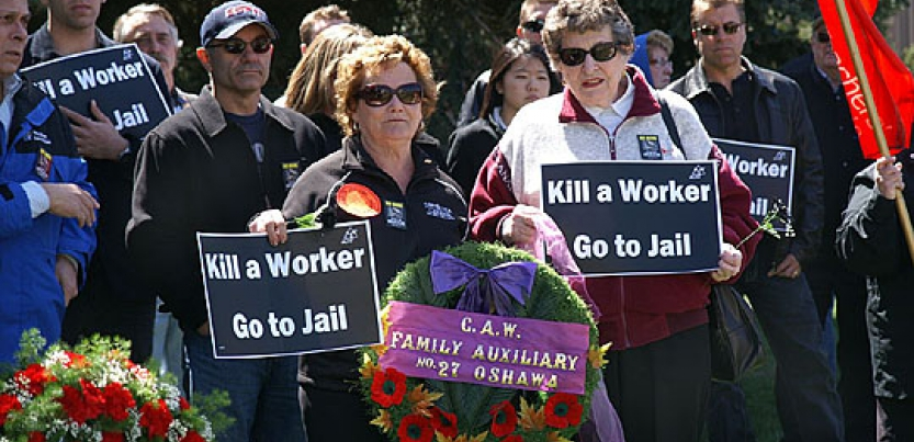 582px version of kill-worker-rally.jpg